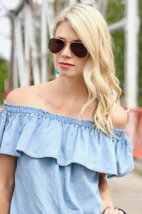 Off the shoulder shirt, tassel earrings, aviator sunglasses