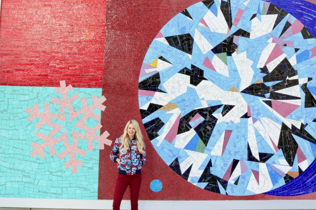 Winter Outfit Inspiration - Floral bomber jacket, moto jeans, ankle boots - Calgary Walls